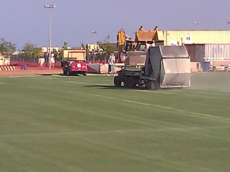 Cleaning and grooming turf at Camp Lemonier, Djibouti, Africa.