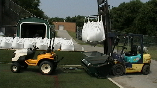 Preparing to topdress a field with S-Fill. Works fantastic over rubber infill.