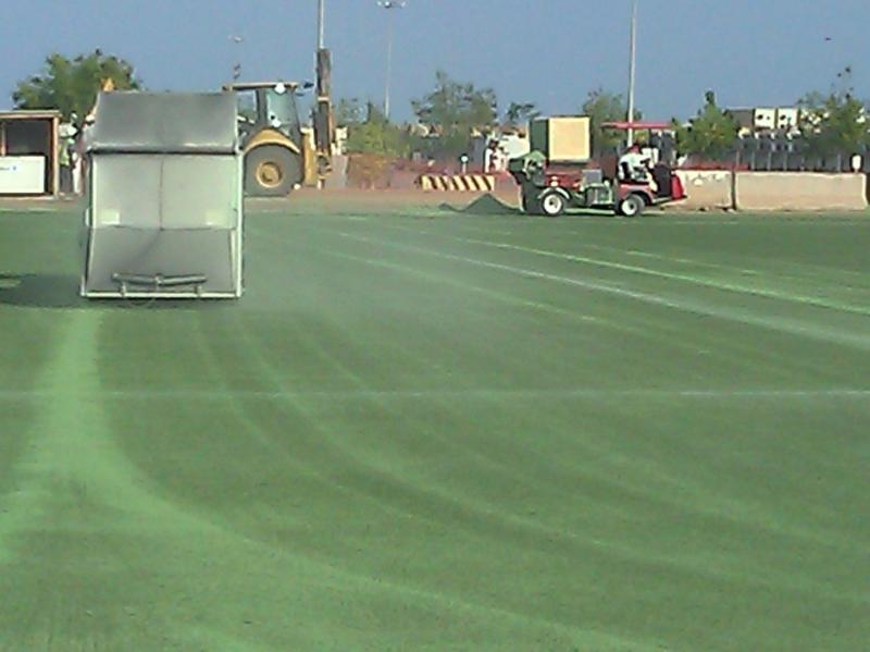 Preparing turf at Camp Lemonier Djibouti, Africa for replacement infill.