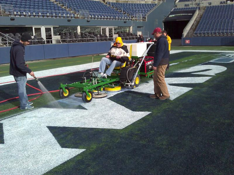 Paint removal in an endzone of the Seattle Seahawks turf field.
